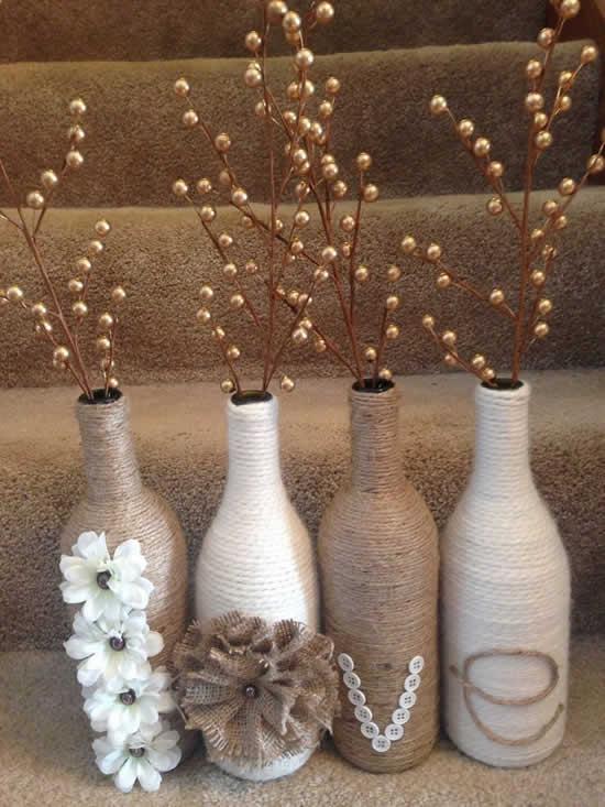 bottiglie riutilizzate come vasi decorativi